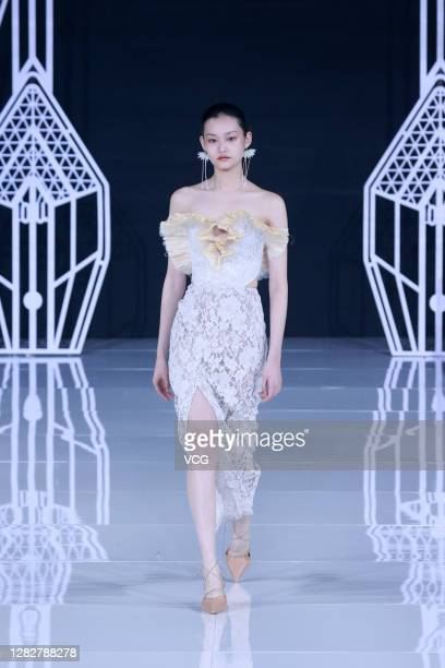 A model showcases designs on the runway during OU collection show by designer Xu Hua on day 5 of China Fashion Week 2021 Spring/Summer at 751DPARK on...