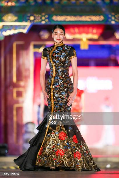 A model showcases designs on the runway during Splendid China Chinese Intangible Cultural Heritage Fashion Shows at The Prince Gong Mansion on June 5...