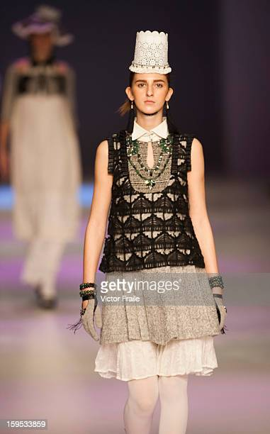 A model showcases designs on the runway during the 13th Footwear design competion on day 2 of Hong Kong Fashion Week Autumn/Winter 2013 at the...