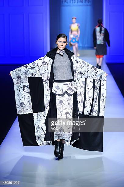 A model showcases designs on the runway during the 22nd Hempel Award China Young Fashion Design Contest on day one of the 2014/15 MercedesBenz China...