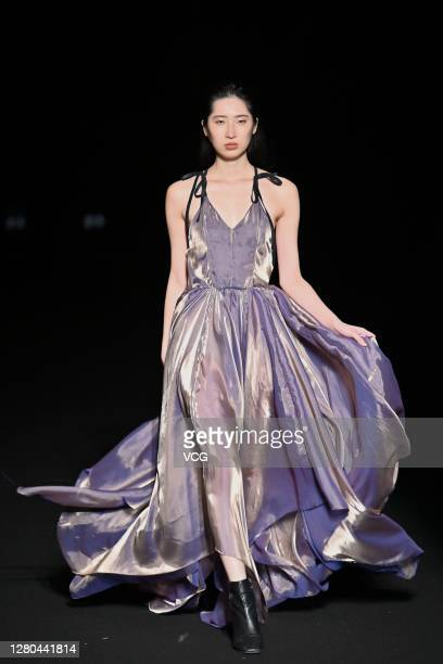 Model showcases designs on the runway during the 8th Asia Fashion Collection of Rakuten Fashion Week TOKYO 2021 spring/summer on October 15, 2020 in...