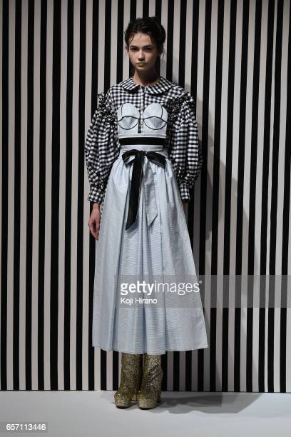 A model showcases designs on the runway during the AKIKOAOKI show as a part of Amazon Fashion Week Tokyo A/W 2017 at Shibuya Hikarie on March 23 2017...