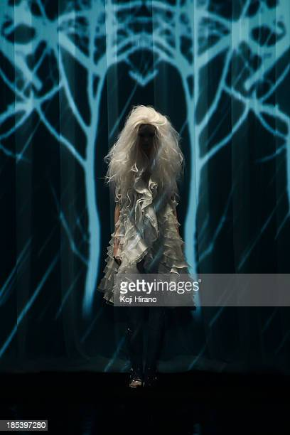 Model showcases designs on the runway during the Alice Auaa show as part of Mercedes Benz Fashion Week TOKYO 2014 S/S at Hikarie B Hall of Shibuya...
