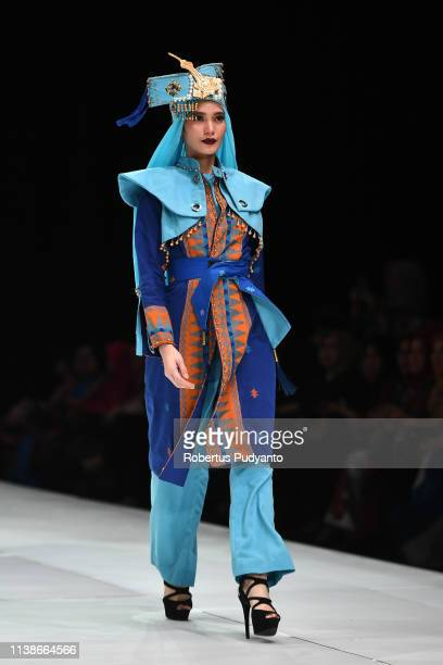 A model showcases designs on the runway during the Amir Malik show as part of Indonesia Fashion Week 2019 on March 27 2019 in Jakarta Indonesia
