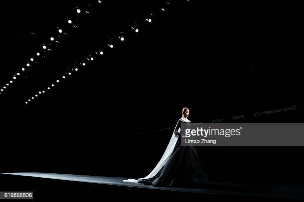 A model showcases designs on the runway during the AMIXAM by Chinese designer Ying Ma show during MercedesBenz China Fashion Week Spring/Summer 2017...