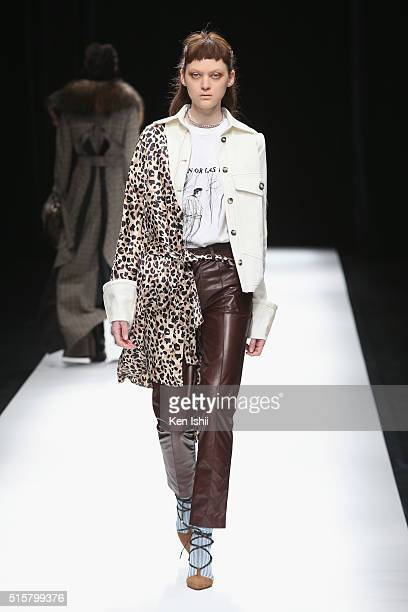 A model showcases designs on the runway during the Anne Sofie Madsen show as a part of Mercedes Benz Fashion Week TOKYO A/W 2016/2017 at Shibuya...