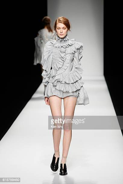A model showcases designs on the runway during the AnneSofie Madsen show as part of Amazon Fashion Week TOKYO 2017 S/S at Shibuya Hikarie on October...