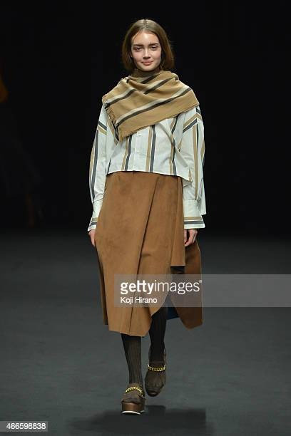 A model showcases designs on the runway during the beautiful people show as part of Mercedes Benz Fashion Week TOKYO 2015 A/W at Shibuya Hikarie on...