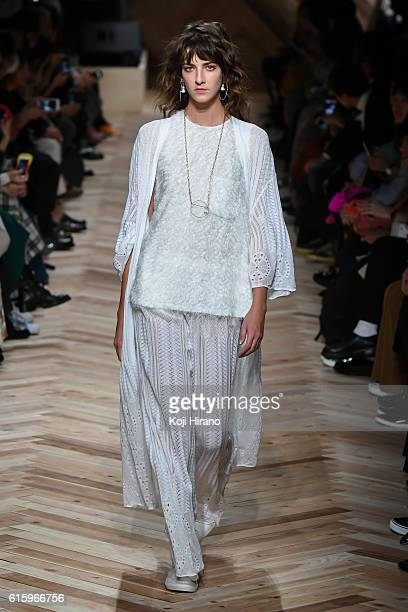 A model showcases designs on the runway during the beautiful people show as part of Amazon Fashion Week TOKYO 2017 S/S at LIVING ROOM on October 20...