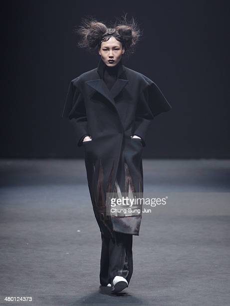 A model showcases designs on the runway during the BIG PARK show as part of Seoul Fashion Week F/W 2014 on March 23 in Seoul South Korea