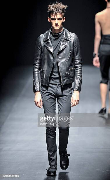 Model showcases designs on the runway during the Christian Dada show as part of Mercedes Benz Fashion Week Tokyo 2014 S/S at Hikarie Hall A of...