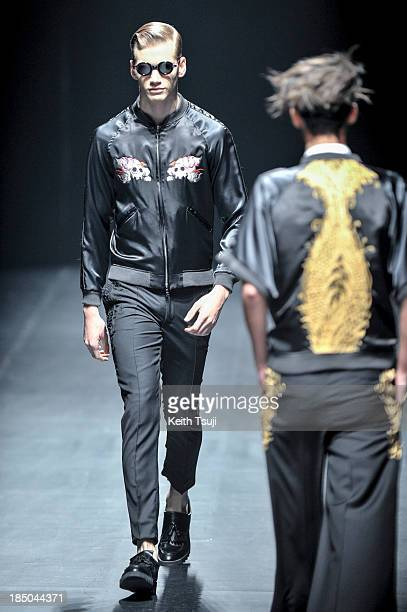 A model showcases designs on the runway during the Christian Dada show as part of Mercedes Benz Fashion Week Tokyo 2014 S/S at Hikarie Hall A of...