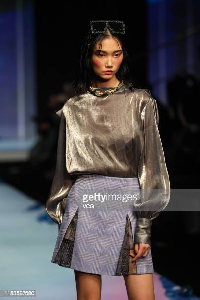 A model showcases designs on the runway during the City Fashion Engine×Beijing | Parcz_Tsai show by designer Zhou Cai on day one of the China Fashion...