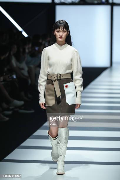 A model showcases designs on the runway during the COMME MOI fall/winter 2019 fashion show on July 22 2019 in Beijing China