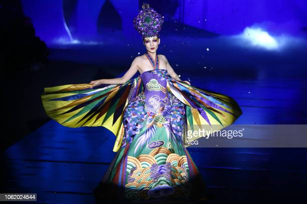 Model showcases designs on the runway during the Creative Rongchang Grass Cloth show by designer Zhang Yichao on day seven of the China Fashion Week...
