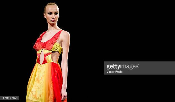 A model showcases designs on the runway during the CUSCS show on day 2 of Hong Kong Fashion Week Spring/Summer 2013 at the Hong Kong Convention and...