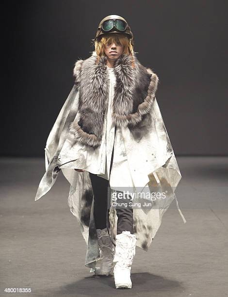 A model showcases designs on the runway during the Dominick's way show as part of Seoul Fashion Week A/W 2014 on March 22 in Seoul South Korea