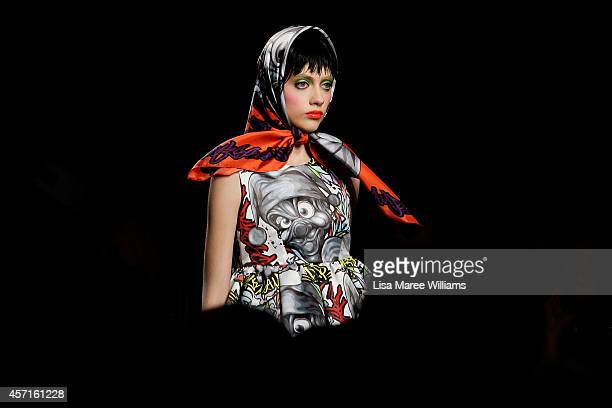 A model showcases designs on the runway during the DRESSCAMP show as part of Mercedes Benz Fashion Week TOKYO 2015 S/S at Shibuya Hikarie on October...