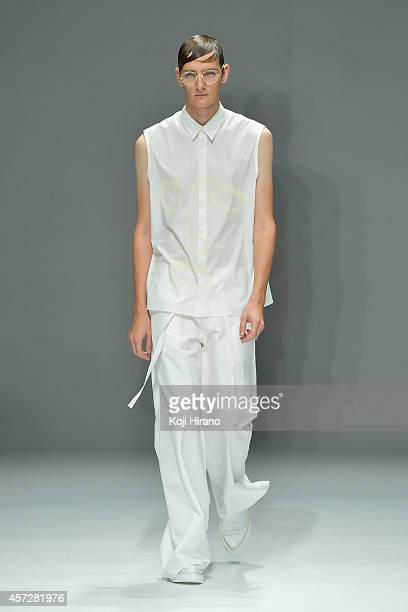 A model showcases designs on the runway during the DRESSEDUNDRESSED show as part of Mercedes Benz Fashion Week TOKYO 2015 S/S at Shibuya Hikarie on...