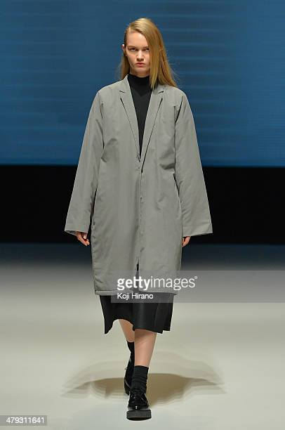 A model showcases designs on the runway during the DRESSEDUNDRESSED show as part of Mercedes Benz Fashion Week TOKYO 2014 A/W at Shibuya Hikarie on...