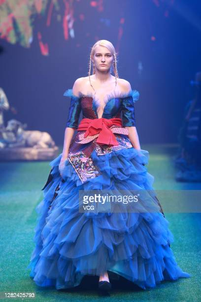 Model showcases designs on the runway during The Genius Mom - Dong Xiang Female Embroider collection show by designer Zhang Zhaoda on day 2 of China...
