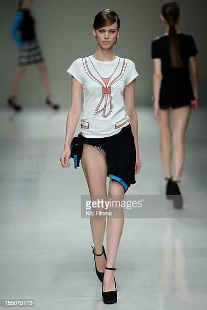 A model showcases designs on the runway during the Han Ahn Soon show as part of Mercedes Benz Fashion Week TOKYO 2014 S/S at Hikarie A Hall of...