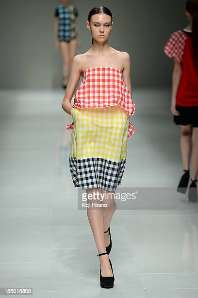 Model showcases designs on the runway during the Han Ahn Soon show as part of Mercedes Benz Fashion Week TOKYO 2014 S/S at Hikarie A Hall of Shibuya...