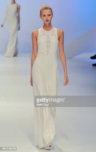 A model showcases designs on the runway during the HANAE MORI designed by Yu Amatsu show as part of Mercedes Benz Fashion Week TOKYO 2015 S/S at...
