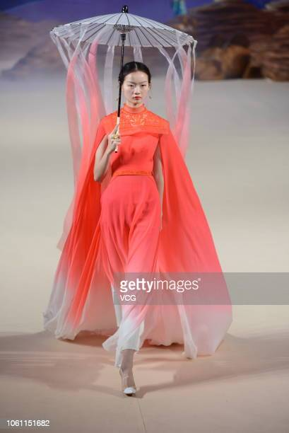 A model showcases designs on the runway during the Heaven Gaia show by designer Xiong Ying on day five of the China Fashion Week Spring/Summer 2019...