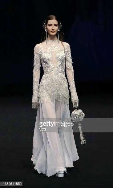 A model showcases designs on the runway during the Heaven Gaia show by designer Xiong Ying on day six of the China Fashion Week Spring/Summer 2020 at...