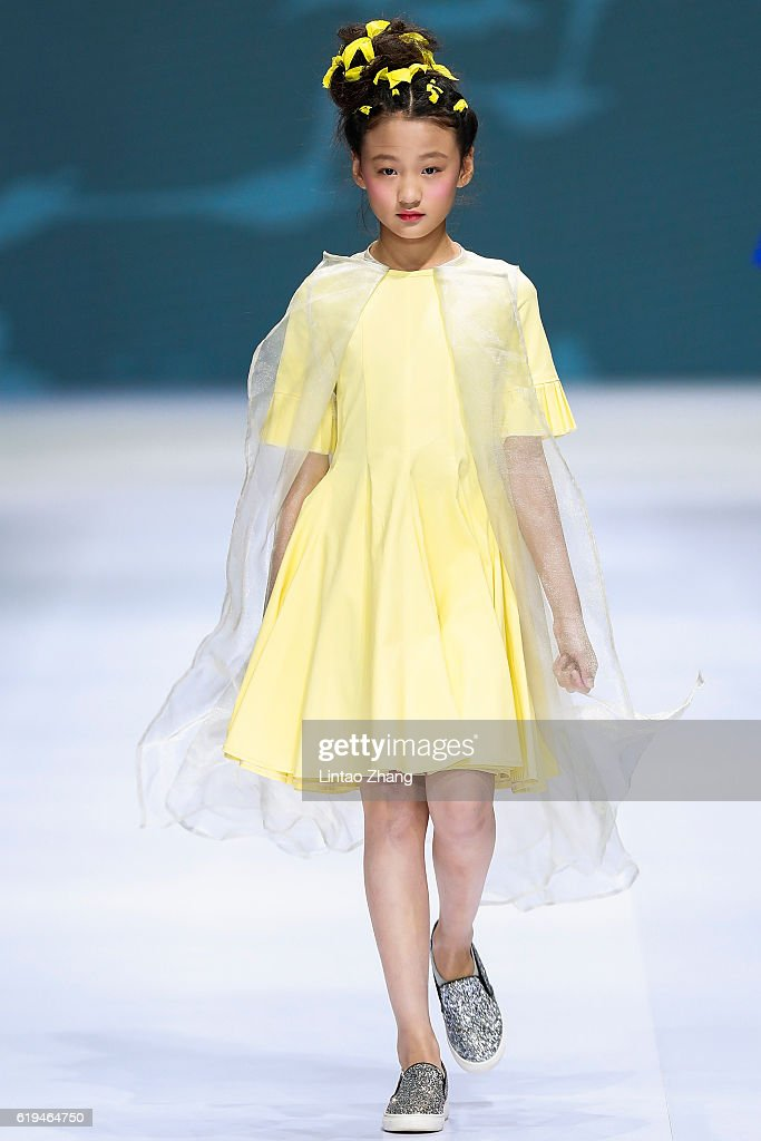 A model showcases designs on the runway during the Hishowkids by Chinese designer Taiyang Chen during Mercedes-Benz China Fashion Week Spring/Summer 2017 at Beijing hotel on October 31, 2016 in Beijing, China. China. The fashion week runs from 25 October to 02 November.