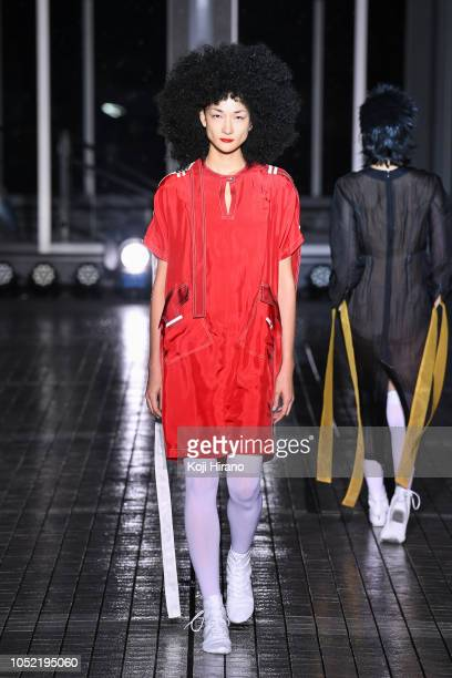 A model showcases designs on the runway during the IHNN show as part of Amazon Fashion Week TOKYO 2019 S/S at Bunka Fashion College Plaza Building on...