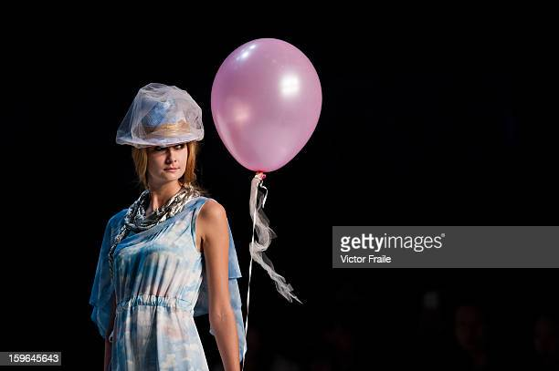 A model showcases designs on the runway during the it S/S 2013 show on day 4 of Hong Kong Fashion Week Autumn/Winter 2013 at the Hong Kong Convention...