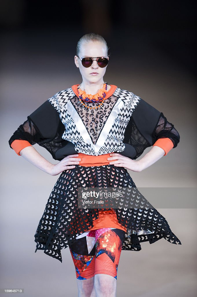 A model showcases designs on the runway during the i.t S/S 2013 show on day 4 of Hong Kong Fashion Week Autumn/Winter 2013 at the Hong Kong Convention and Exhibition Centre on January 17, 2013 in Hong Kong, China.