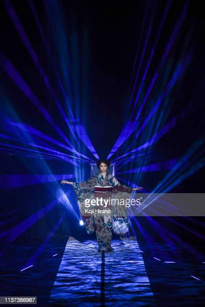 Model showcases designs on the runway during the JOTARO SAITO show as part of Amazon Fashion Week TOKYO 2019 A/W at Shibuya Hikarie Hall on March 20,...