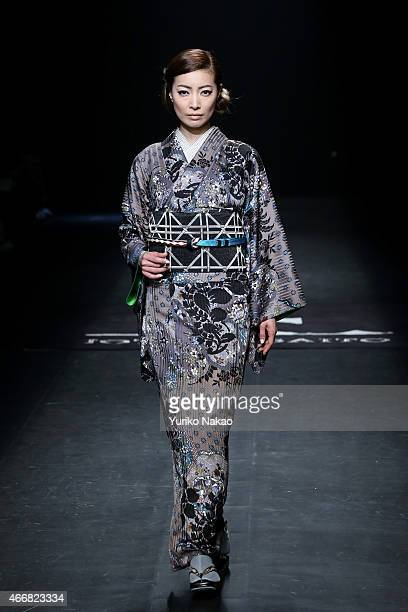 A model showcases designs on the runway during the JOTARO SAITO show as part of Mercedes Benz Fashion Week TOKYO 2015 A/W at Shibuya Hikarie on March...