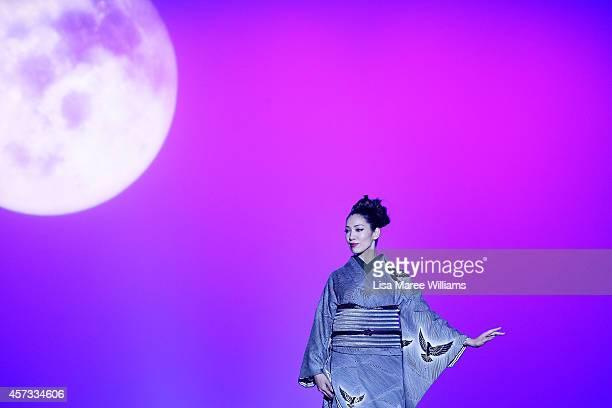 A model showcases designs on the runway during the JOTARO SAITO/SANSAI SAITO show as part of Mercedes Benz Fashion Week TOKYO 2015 S/S at Shibuya...