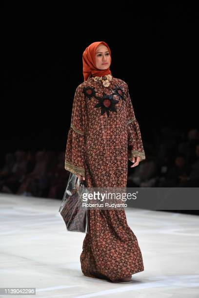 A model showcases designs on the runway during the Kamilaa by Itang Yunasz show as part of Indonesia Fashion Week 2019 on March 29 2019 in Jakarta...