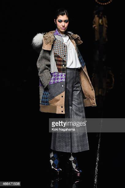 A model showcases designs on the runway during the KEITA MARUYAMA show as part of Mercedes Benz Fashion Week TOKYO 2015 A/W at Shibuya Hikarie on...
