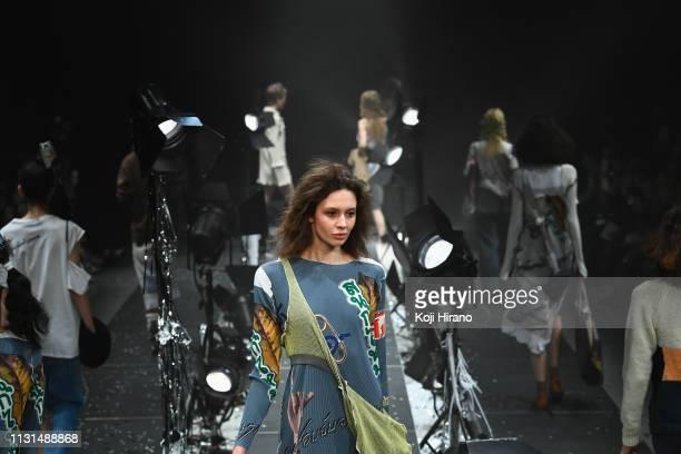 Model showcases designs on the runway during the kotohayokozawa show as part of Amazon Fashion Week TOKYO 2019 A/W at Shibuya Hikarie Hall on March...