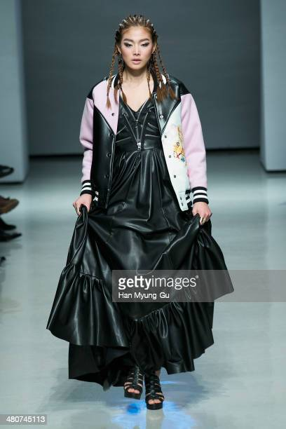A model showcases designs on the runway during the Kwak Hyun Joo Collection show as part of Seoul Fashion Week A/W 2014 on March 26 in Seoul South...