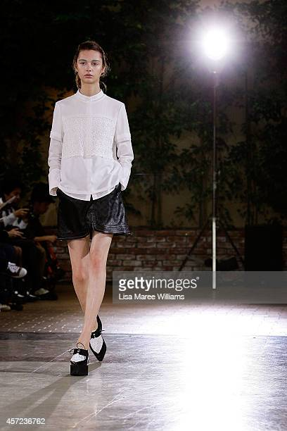 A model showcases designs on the runway during the LAMARCK show as part of Mercedes Benz Fashion Week TOKYO 2015 S/S at Shibuya Hikarie on October 15...