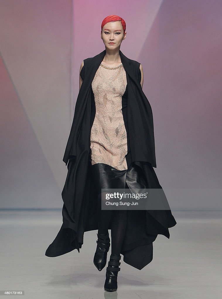 A model showcases designs on the runway during the Lie Sang Bong show as part of Seoul Fashion Week F/W 2014 on March 23, 2014, in Seoul, South Korea.