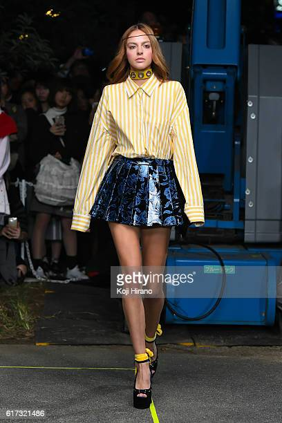 A model showcases designs on the runway during the MIKIO SAKABE show as part of Amazon Fashion Week TOKYO 2017 S/S at the Miyashita Park on October...