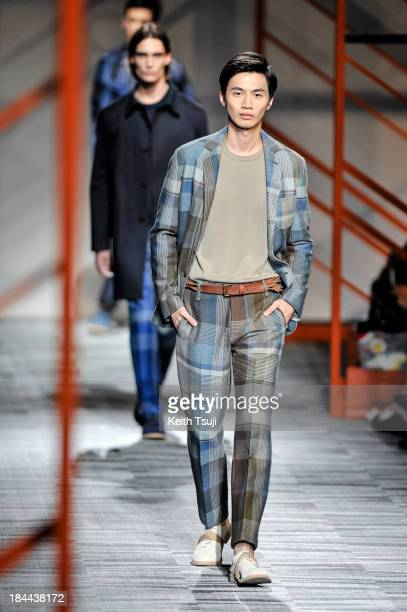 Model showcases designs on the runway during the Missoni show as part of Mercedes Benz Fashion Week Tokyo S/S 2014 at Hikarie Hall A of Shibuya...