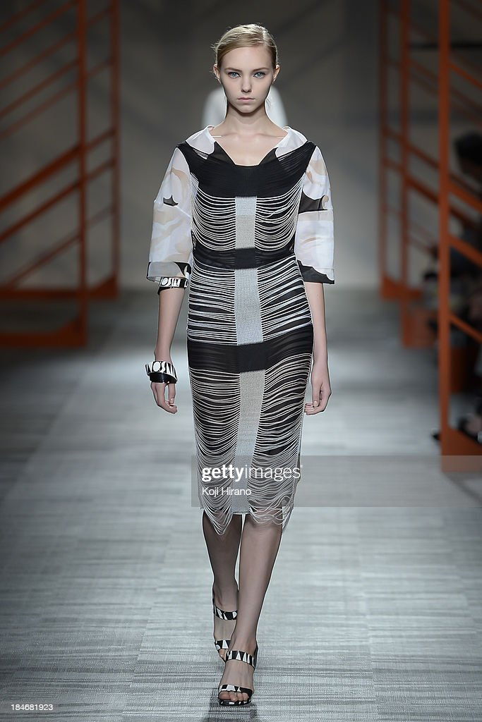 A model showcases designs on the runway during the Missoni show as part of Mercedes Benz Fashion Week Tokyo S/S 2014 at Hikarie Hall A of Shibuya Hikarie on October 14, 2013 in Tokyo, Japan.