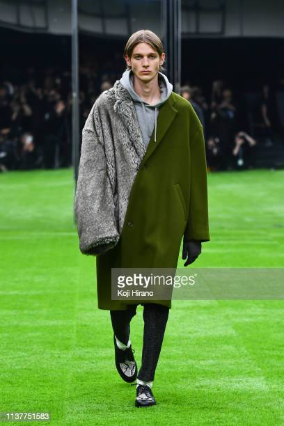 Model showcases designs on the runway during the MISTERGENTLEMAN show as part of Amazon Fashion Week TOKYO 2019 A/W at Shibuya Hikarie Hall on March...