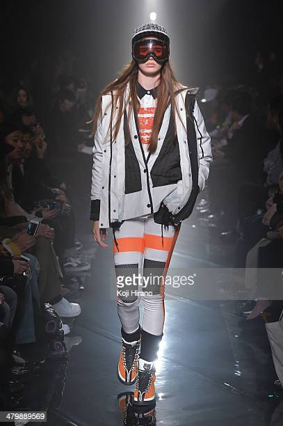 A model showcases designs on the runway during the Onitsuka Tiger x ANDREA POMPILIO show as part of Mercedes Benz Fashion Week TOKYO 2014 A/W at the...