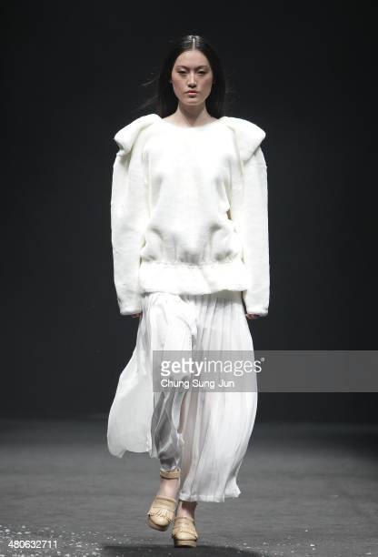 A model showcases designs on the runway during the Paul and Alice show as part of Seoul Fashion Week F/W 2014 on March 26 in Seoul South Korea