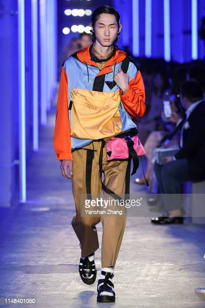 Model showcases designs on the runway during the Prada Spring / Summer 2020 Menswear Fashion Show on June 6, 2019 in Shanghai, China.